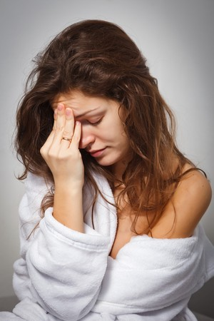 headshrinker: Young woman suffering from headache Stock Photo