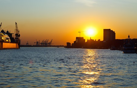 Sunset in port of Hamburg, Germany photo