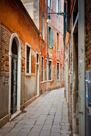 Narrow street in Venice photo