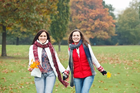 Two pretty girls having fun in a park Stock Photo - 8544130