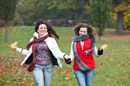 Two pretty girls having fun in a park Stock Photo - 8544142