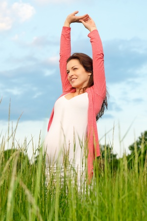 Outdoor portrait of beautiful pregnant woman photo