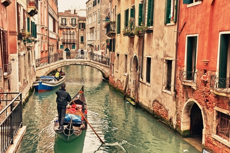Gondola on canal in Venice photo