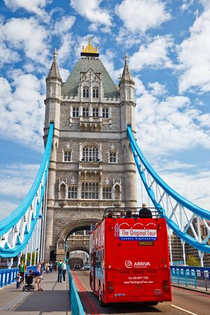 LONDON - MAY 2009: Tourists visit Tower Bridge in London, UK. Tower Bridge is crossed by over 40,000 people (motorists, cyclists and pedestrians) every day.