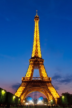 PARIS - MAY 28, 2008: Eiffel Tower brightly illuminated at dusk on May 28, 2008 in Paris. The Eiffel tower is the most visited monument of France.