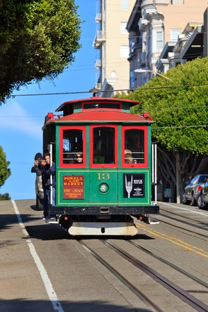 SAN FRANCISCO - NOVEMBER 26, 2010: Cable car runs on November 26, 2010 in San Francisco, California. Cable car is the oldest mechanical public transport in San Francisco which is in service since 1873.