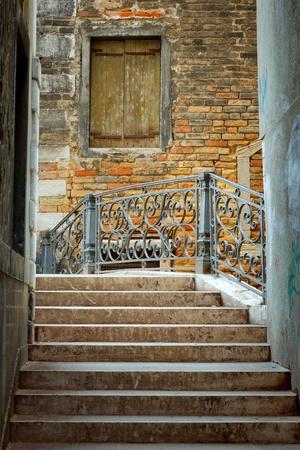 Narrow street in Venice photo