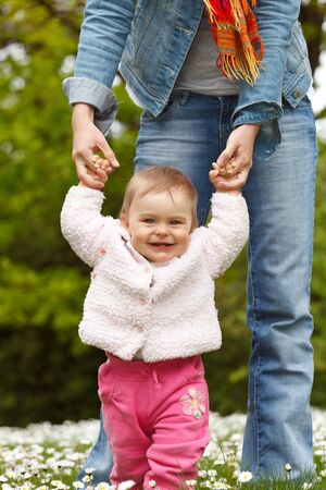 toddler walking: First steps Stock Photo
