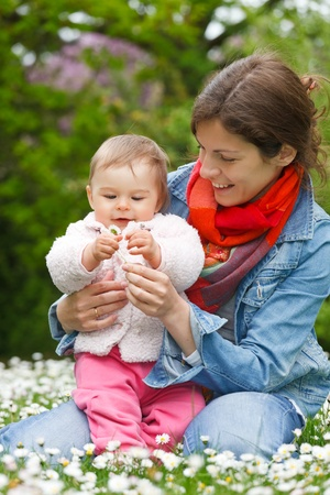 Mother with baby in the park Stock Photo - 9431081