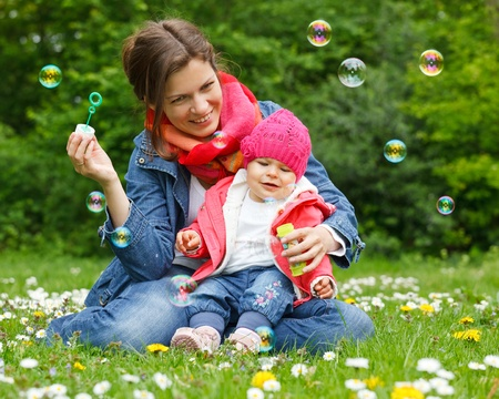 Mother with baby in the park Stock Photo - 9431080