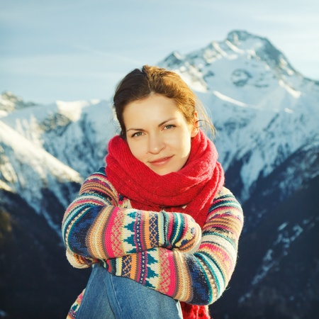 Attractive girl with mountains in background Stock Photo - 9696076