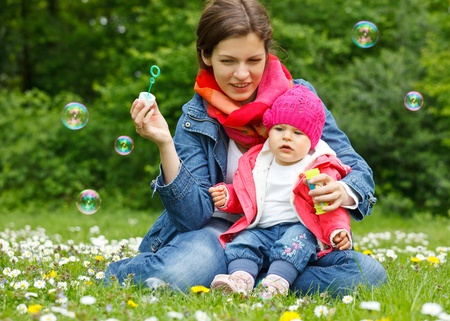 positive feelings: Mother with baby playing in the park