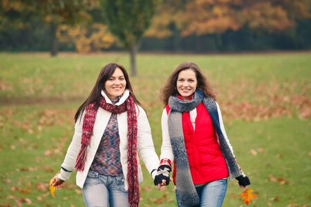 Two pretty girls having fun in the park Stock Photo - 9791341