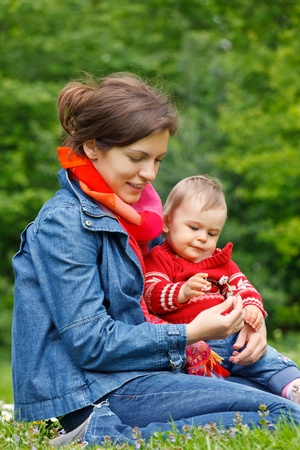 Mother with baby playing in the park Stock Photo - 9791350