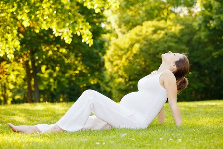 Beautiful pregnant woman in the park Stock Photo - 9950589