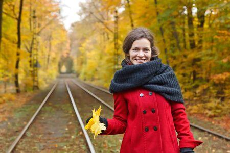 Happy woman in autumn park Stock Photo - 9950239