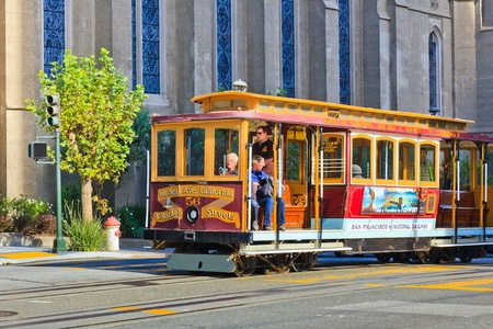 SAN FRANCISCO - NOVEMBER 26, 2010: Passengers enjoy a ride in a cable car in San Francisco, California. It is the oldest mechanical public transport in San Francisco which is in service since 1873. Stock Photo - 9916201