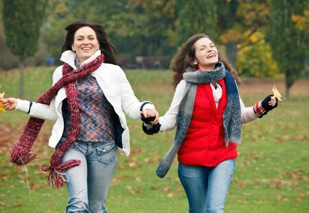 Two pretty girls in the park Stock Photo - 10243342