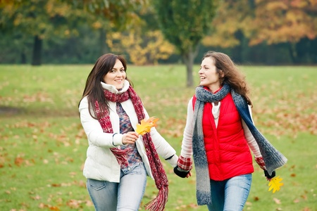 Two pretty girls in the park photo