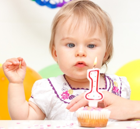 one year: Little girl celebrating first birthday