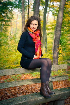 Young woman in autumn park Stock Photo - 10606720