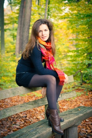 Young woman in autumn park photo