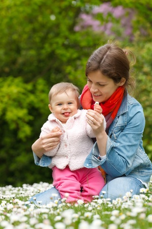 Mother with baby in the park Stock Photo - 10654216