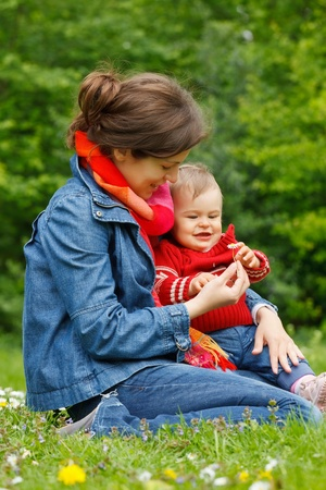 Mother with baby in the park Stock Photo - 10654294