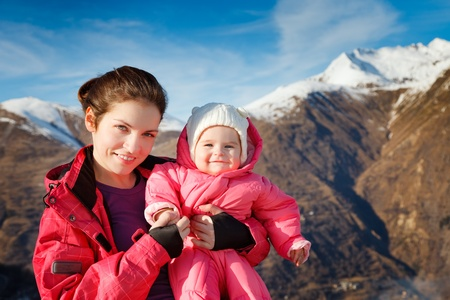 outwear: Mother with baby in sport outwear