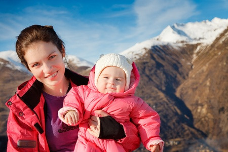Mother with baby in sport outwear photo