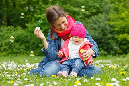 Mother with baby in the park photo