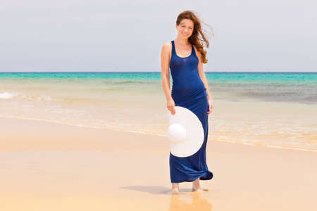 wet dress: Young woman on the ocean beach Stock Photo