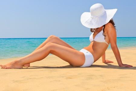 Young woman enjoy sun on the beach photo