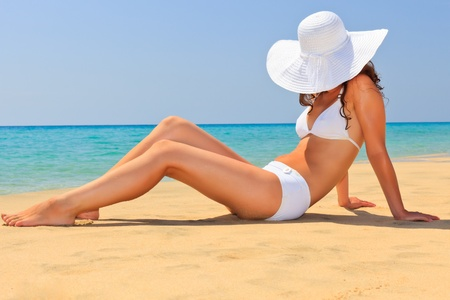 tanned body: Young woman enjoy sun on the beach Stock Photo