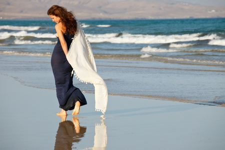 Young woman on a beach photo