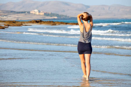 Young woman enjoing the ocean beach photo