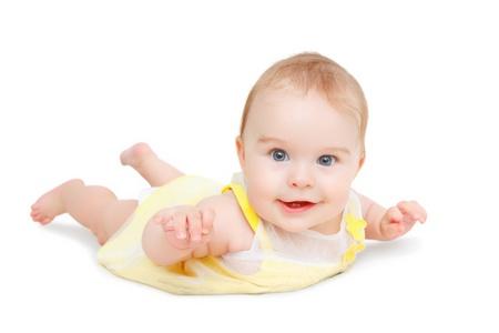 bright eyed: Crawling blue-eyed baby on white background