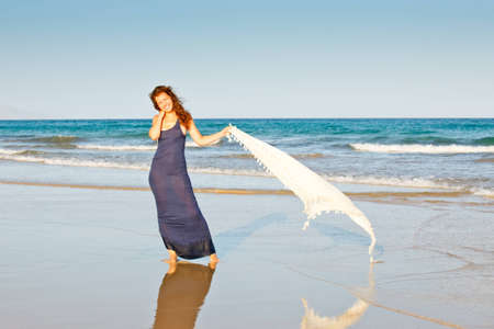Young woman on the beach photo