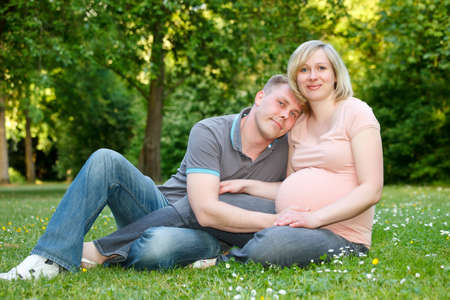 Pregnant couple in the park Stock Photo - 12787309