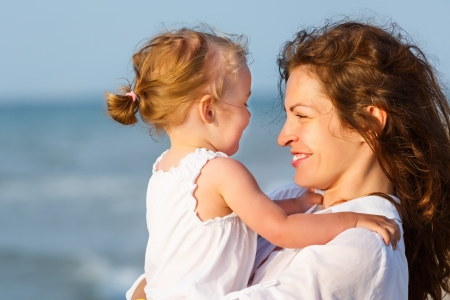 Mother and daughter on the beach Stock Photo - 14346909
