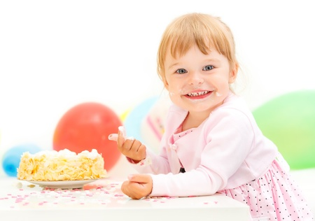 Little girl celebrating second birthday photo