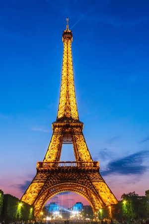 PARIS - MAY 22, 2008: Eiffel Tower brightly illuminated at dusk on May 22, 2008 in Paris. The Eiffel tower is the most visited monument of France.