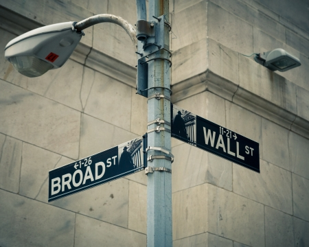 city trip: Street signs of Wall street and Broad street, New York