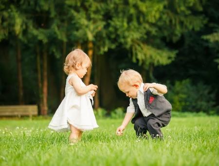 flowers boy: Children in the park Stock Photo