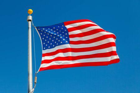 US Flag over blue sky Stock Photo - 15504961