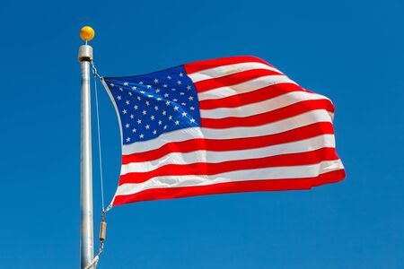 US Flag over blue sky Stock Photo - 15504961
