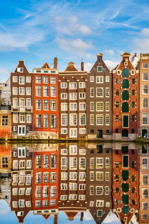 canal house: Traditional dutch buildings on canal in Amsterdam Stock Photo
