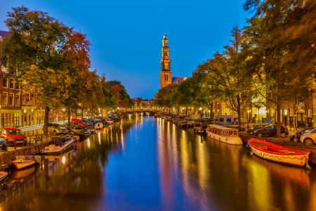 Western church on Prinsengracht canal in Amsterdam photo
