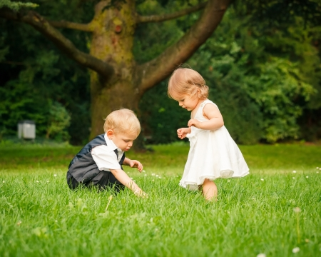 Little boy and girl in the park Stock Photo