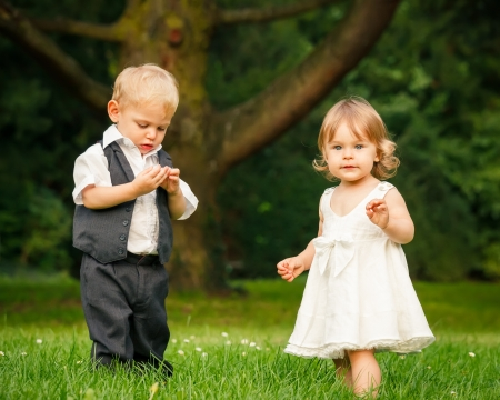 kids dress: Little boy and girl in the park Stock Photo